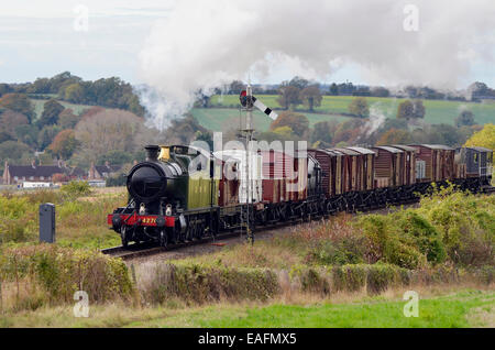 A n ex-GWR 42XX class steam tank engine works a demonstration goods train showing how freight was moved in the 1950's - Stock Photo