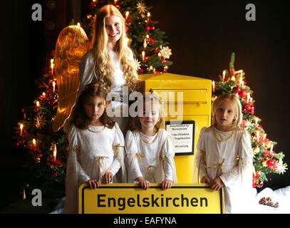 Engelskirchen, Germany. 14th Nov, 2014. Actors portraying baby Jesus (Christkind) stands with children at a mailbox - Stock Photo