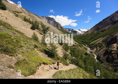 Hiker in Torres Del Paine National Park, Chile - Stock Photo