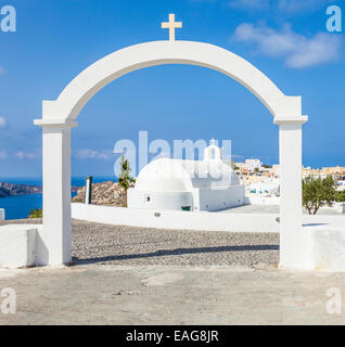 White Church of Agios Vasilios overlooking Aegean Sea, Oia, Santorini, Cyclades Islands, Greek Islands, Greece, - Stock Photo