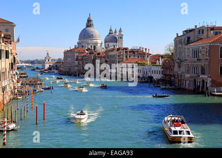 Water taxis on the Grand Canal and Santa Maria della Salute Dorsoduro from the Accademia Bridge Venice Italy - Stock Photo