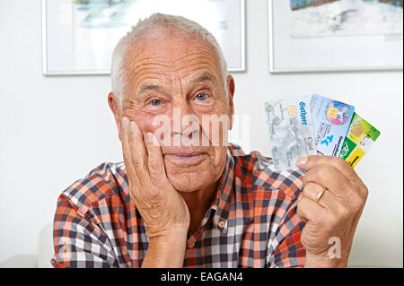 Senior with health insurance cards - Stock Photo