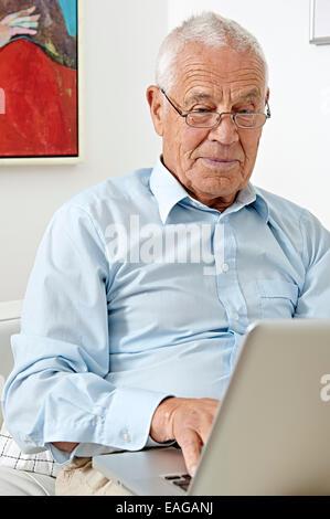 Senior with a laptop - Stock Photo