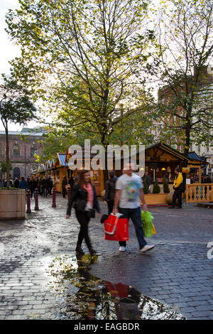 Manchester UK, 14th November, 2014.  St Annes Square on the opening Day of Christmas market in St Ann's Square attracting - Stock Photo