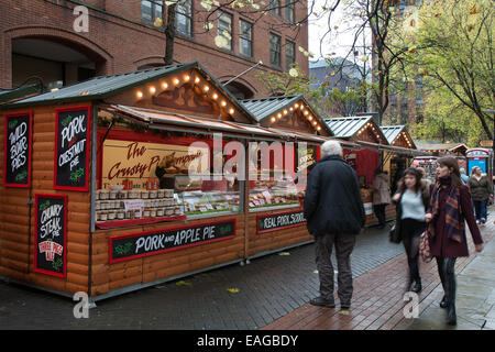 Market traders Manchester UK, 14th November, 2014.  Pork & Apple Pie from the Crusty Pie Company at the opening - Stock Photo