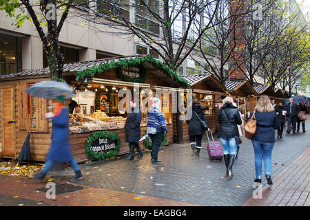 Market traders Manchester UK, 14th November, 2014.  Dutch Cookieman  Opening Day of Christmas market in Brazennose - Stock Photo