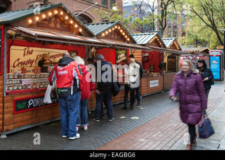 Market traders Manchester UK, 14th November, 2014.  The Crusty Pie Company at the opening Day of Christmas market - Stock Photo