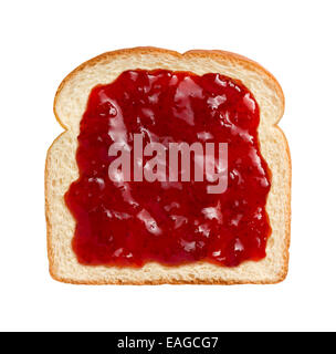 Aerial view of bright red strawberry preserves, spread over a slice of white bread. - Stock Photo