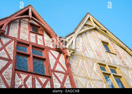 Old half-timbered and brick buildings on main square of Montrichard - Stock Photo