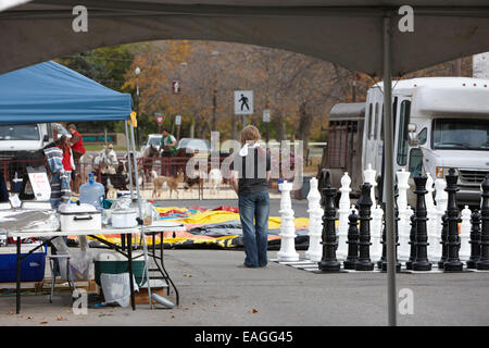 setting up street entertainment as part of local fair and market swift current Saskatchewan Canada - Stock Photo