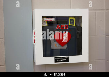 aed automated external defibrillator installed in a high school public place Saskatchewan Canada - Stock Photo