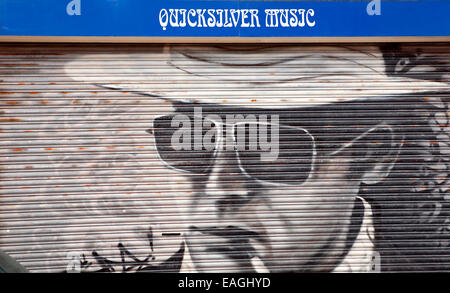 Roller shutters painted with murals, Southport, Merseyside, UK - Stock Photo