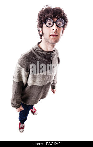 an handsome guy, maybe a student, in casual clothing with thick glasses and a nerdy look. isolated on white - Stock Photo