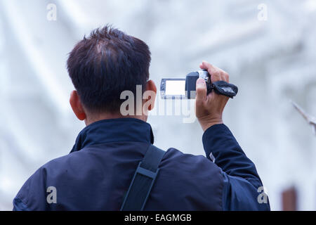 male recording temple with digital video recorder - Stock Photo