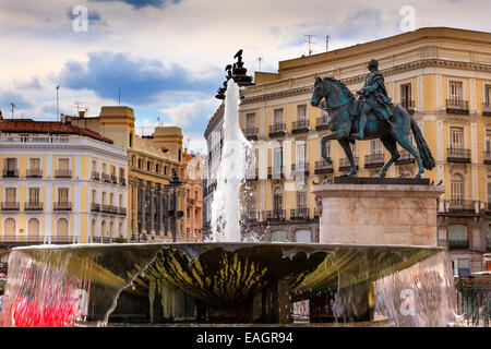 Puerta del Sol Gate of the Sun Most Famous Square Fountain King Carlos III Equestrian Statue in Madrid Spain King - Stock Photo