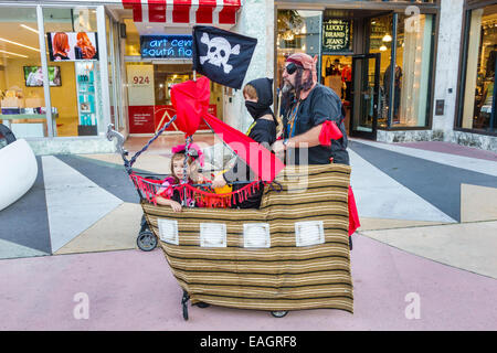Miami Beach Florida Lincoln Road pedestrian mall Halloween costume wearing outfit character man father boy son girl - Stock Photo