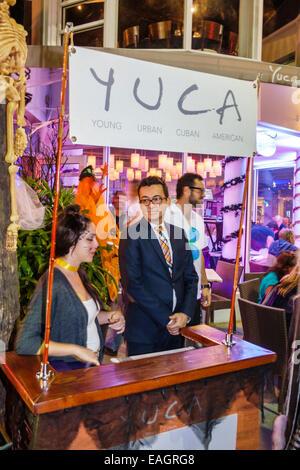 Miami Beach Florida Lincoln Road pedestrian mall YUCA restaurant host hostess night nightlife - Stock Photo