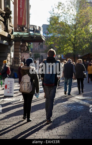 Manchester UK, 14th November, 2014.  Opening Day of Christmas market in St Annes Square attracting shoppers from - Stock Photo