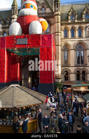 Manchester UK, 20th November, 2014. Extensions to Christmas Spinning Fields xmas market  Festive seasonal stalls - Stock Photo