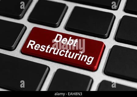 debt restructuring red button on keyboard, business concept - Stock Photo