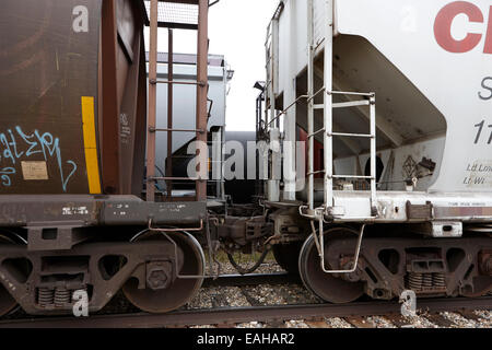 freight grain trucks coupling on canadian pacific railway Saskatchewan Canada - Stock Photo