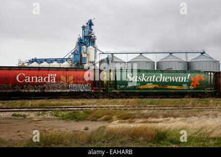 canada and saskatchewan freight grain trucks on canadian pacific railway Saskatchewan Canada - Stock Photo