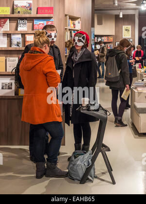 Berlin, Germany, 15th November 2014. Booklovers don masks and gather to support Ocelot bookshop. Owner, Frithjof - Stock Photo