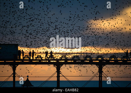 Aberystwyth Wales UK, Saturday  15 November 2014  People standing on Aberystwyth's pier at sunset get a close up - Stock Photo