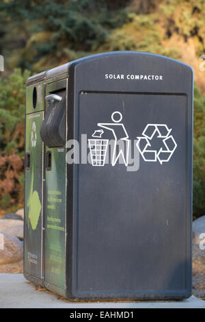 Recycle bin with solar compactor on university campus - Stock Photo