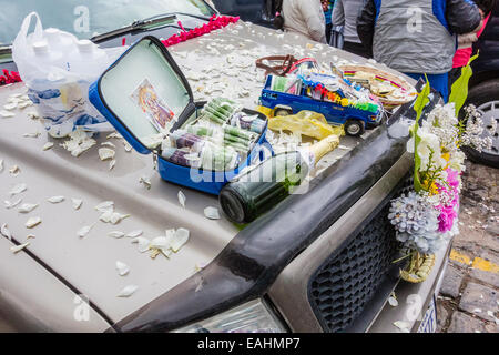 Objects laid out on the hood of a truck for good luck and wishes for the coming year during the blessing of the - Stock Photo