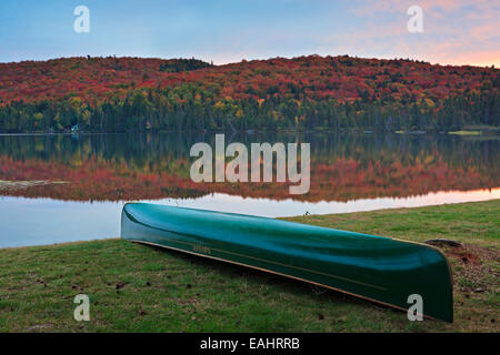 Canoe on the shores of Rock Lake during sunset in Algonquin Provincial Park, Ontario, Canada. - Stock Photo