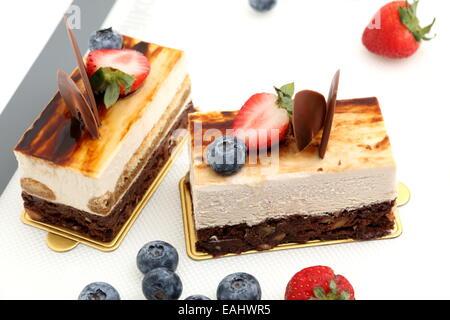 brownie tiramisu cake white fresh strawberry on mat - Stock Photo