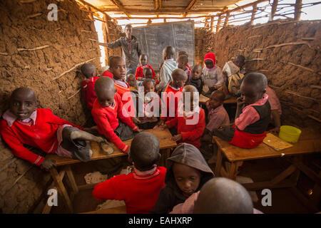 Students learn in a crowded classroom in Kajiado County, Kenya. - Stock Photo
