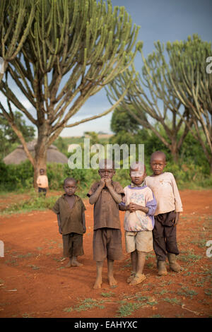 Children stand along a village road in remote Bukwo District, Uganda, East Africa. - Stock Photo
