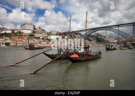 Rabelo traditional boats on Douro river, Dom Luis I Bridge, old city of Porto in Portugal. - Stock Photo