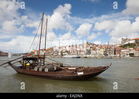 City of Porto in Portugal. Rabelo traditional Portuguese cargo boat with Port wine barrels on Douro river. - Stock Photo