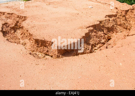 landslide along the road by water and wind in thailand - Stock Photo