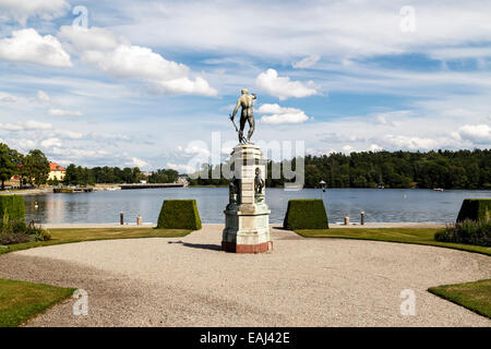 Rear of bronze statue overlooking water in front of Drottningholm Palace Stockholm Sweden - Stock Photo