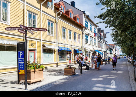 Street with traditional painted timber houses, Vaxholm, Stockholm, Sweden - Stock Photo