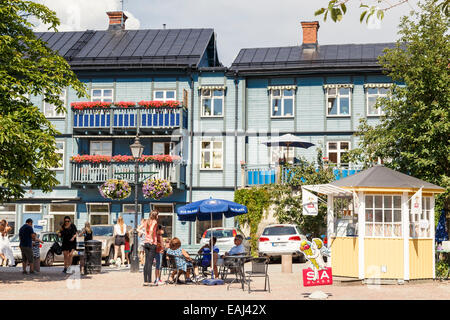Holiday-makers enjoying sunshine, Vaxholm, Stockholm, Sweden - Stock Photo