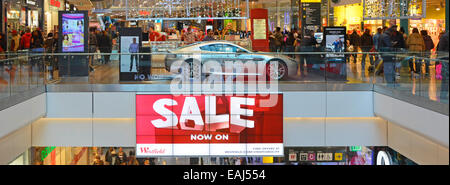 Interior view of Westfield shopping malls at January sale time with some Christmas decorations still in place - Stock Photo