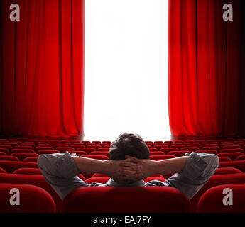 cinema screen red curtains opening for vip person - Stock Photo