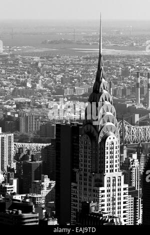 The Chrysler Building New York city overlooking the lower east side and a bridge in the background photographed - Stock Photo