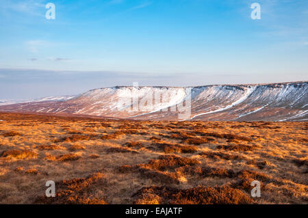 Wide open moorland near the Pennine way above Glossop in Derbyshire. Remains of late snow on the Northern edge of - Stock Photo