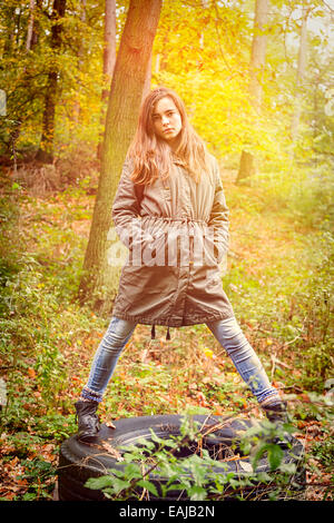portrait of a beautiful teenage girl in an autumn forest - Stock Photo