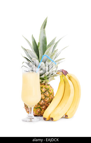 Bananas, pineapple and a glass of juice - Stock Photo