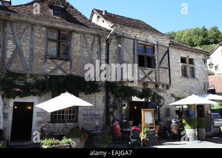Restaurant Lou Fouare in the pretty medieval village of Saint-Cirq Lapopie, Midi-Pyrenees, Lot, france - Stock Photo