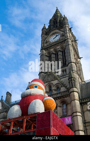 Father Christmas outside the Town Hall clock tower, Albert Square, Manchester, England, UK - Stock Photo