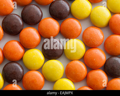 A close-up of Reese's Pieces peanut butter candy. Manufactured by The Hershey Company. - Stock Photo
