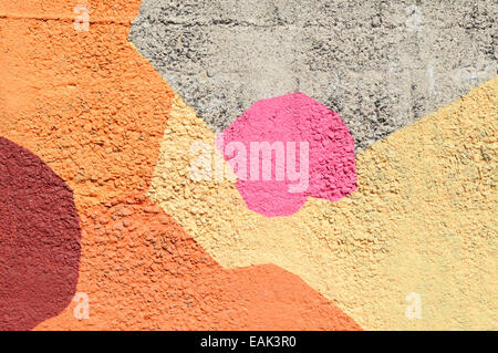 Bright geometric pattern painted on a sea defense Giardini Naxos Sicily Italy - Stock Photo